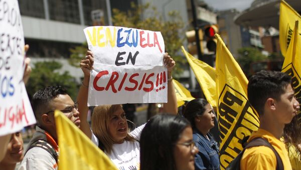 People protest against the Sao Paulo Forum in Caracas, Venezuela, Friday, July 26, 2019. Venezuela is hosting leftist activists from around Latin America at the forum that has been criticized by opponents who say the fragile country can hardly afford to entertain hundreds of international guests. - Sputnik International
