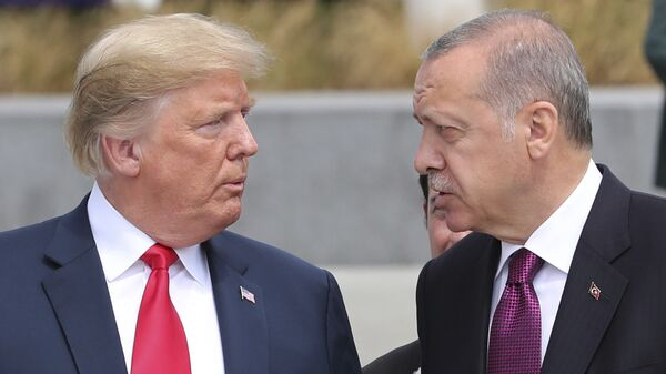 U.S. President Donald Trump, left, talks to Turkish President Recep Tayyip Erdogan, right, as they tour the new NATO headquarters in Brussels, Belgium, Wednesday, July 11, 2018. NATO countries' heads of states and governments gather in Brussels for a two-day meeting.  - Sputnik International