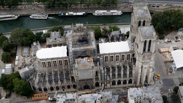 A view shows the damaged roof of Notre-Dame de Paris during restoration work, three months after a fire that devastated the cathedral in Paris - Sputnik International