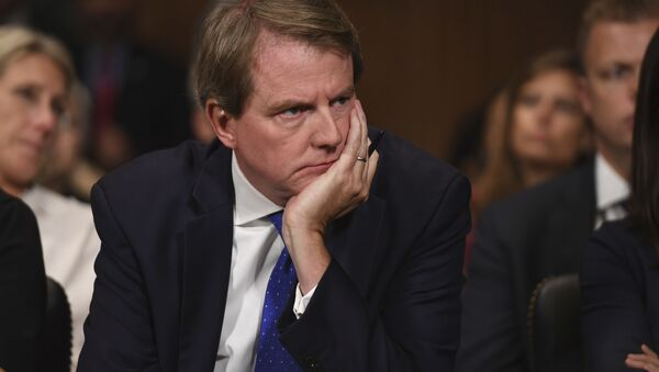 White House counsel Don McGahn listens as Supreme court nominee Brett Kavanaugh testifies before the Senate Judiciary Committee on Capitol Hill in Washington, Thursday, Sept. 27, 2018. - Sputnik International