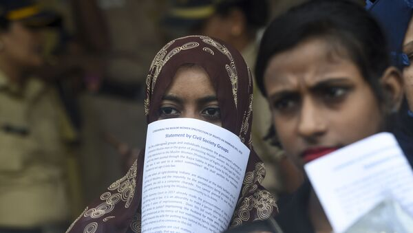 Women take part in a protest against the recent passage of a law to criminalise instant divorce for Muslims in Mumbai on August 1, 2019 - Sputnik International