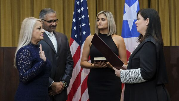 Justice Secretary Wanda Vazquez is sworn in as governor of Puerto Rico by Supreme Court Justice Maite Oronoz, in San Juan, Puerto Rico, Wednesday, Aug. 7, 2019. Vazquez took the oath of office early Wednesday evening at the Puerto Rican Supreme Court, which earlier in the day ruled that Pedro Pierluisi's swearing in last week was unconstitutional. Vazquez was joined by her daughter Beatriz Diaz Vazquez and her husband Judge Jorge Diaz. - Sputnik International