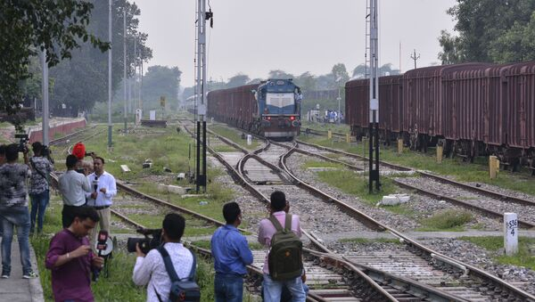 Journalists wait by the station as the Samjhauta Express, a train that runs between Delhi in India and Lahore in Pakistan, arrives in Attari, a town along the border with Pakistan, in the northern Indian state of Punjab, Thursday, Aug. 8, 2019 - Sputnik International