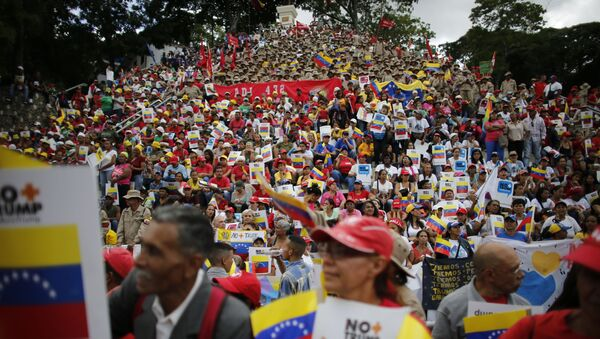 Government supporters gather for a rally to protest against economic sanctions imposed by the administration of U.S. President Donald Trump, in Caracas, Venezuela, Saturday, Aug. 10, 2019. - Sputnik International