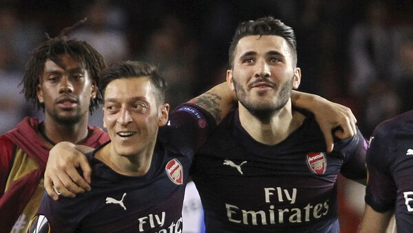 FILE - In this Thursday, May 9, 2019 file photo, Arsenal defender Sead Kolasinac, right celebrates with Arsenal midfielder Mesut Ozil, left, at the end of the Europa League semifinal soccer match, second leg, between Valencia and Arsenal at the Camp de Mestalla stadium in Valencia, Spain.  - Sputnik International