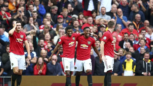 Manchester United's Anthony Martial, 2nd right, celebrates with teammates after scoring his sides second goal during the English Premier League soccer match between Manchester United and Chelsea at Old Trafford in Manchester, England, Sunday, Aug. 11, 2019 - Sputnik International