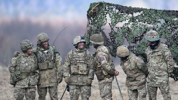 British artillery soldiers react during the 'Dynamic Front 18' exercise in Grafenwoehr, near Eschenbach, southern Germany, on March 7, 2018. 'Dynamic Front 18' is US Army's largest annual artillery exercise in Europe, including more than 3,700 participants from 27 nations.  - Sputnik International