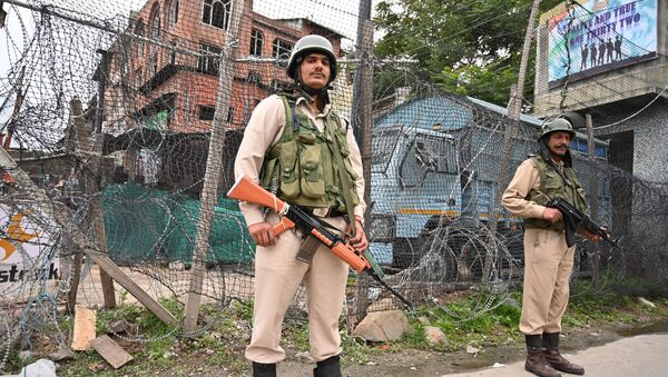 Indian paramilitary troopers stand guard in Srinagar on June 12, 2019, following an attack to a Central Reserve Police Force (CRPF) patrol were at least two Central CRPF personnel were killed during the suspected militant attack in south Kashmir's Anantnag district along the KP road - Sputnik International