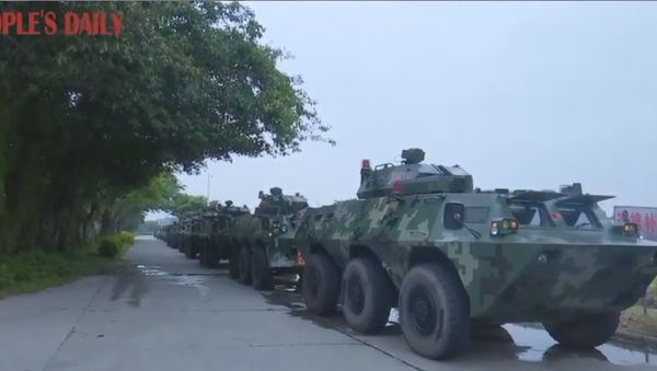 Convoy of armored personnel carriers belonging to the Chinese People's Armed Police Force seen traveling to Guangdong's Shenzhen region ahead of drills  - Sputnik International