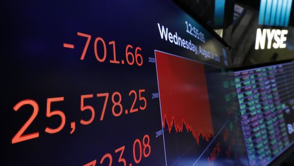 A screen above the trading floor shows an intraday number for the Dow Jones industrial average, at the New York Stock Exchange, Wednesday, 14 August 2019. Stocks are falling sharply after the bond market threw up another warning flag on the economy.  - Sputnik International