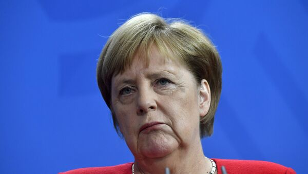 German Chancellor Angela Merkel reacts during a press conference with Moldova's Prime Minister at the Chancellery in Berlin on July 16, 2019. - Sputnik International
