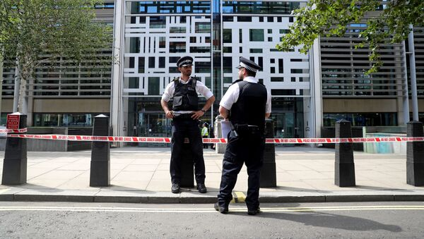 Police officers stand guard in front of the Home Office in London - Sputnik International