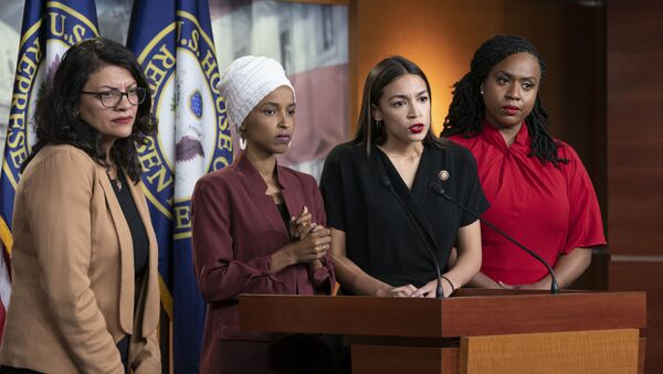 Rep. Rashida Tlaib, D-Mich., Rep. Ilhan Omar, D-Minn., Rep. Alexandria Ocasio-Cortez, D-N.Y., and Rep. Ayanna Pressley, D-Mass., respond to remarks by President Donald Trump after his call for the four Democratic congresswomen to go back to their broken countries. - Sputnik International