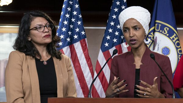 In this July 15, 2019, file photo, U.S. Rep. Ilhan Omar, D-Minn, right, speaks, as U.S. Rep. Rashida Tlaib, D-Mich. listens, during a news conference at the Capitol in Washington. - Sputnik International