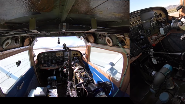 The Air Force Research Laboratory and DZYNE Technologies Incorporated's first two-hour flight using the Robotic Pilot Unmanned Conversion Program called ROBOpilot in a 1986 Cessna 206. August 9. (Screenshot via YouTube) - Sputnik International