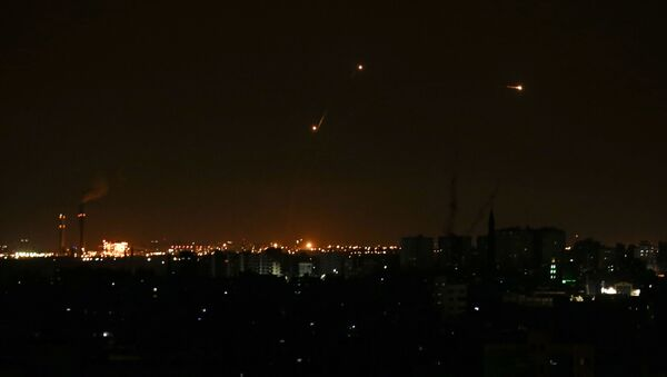 Three missile from the Iron Dome air defence system, designed to intercept and destroy incoming short-range rockets and artillery shells, from a position in the southern Israeli are seen from Gaza city on June 20, 2018.  - Sputnik International