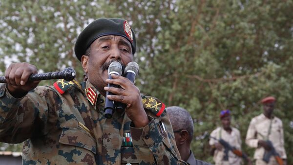 In this June 29, 2019, file photo, Sudanese Gen. Abdel-Fattah Burhan, head of the military council, speaks during a military-backed rally, in Omdurman district, west of Khartoum, Sudan. An African Union envoy says Sudan's ruling military council and the country's pro-democracy movement have reached a power-sharing agreement, including a timetable for a transition to civilian rule. Mohammed el-Hassan Labat said early Friday, July 5, that both sides agreed to form a joint sovereign council that will rule the country for three years or a little more. The sides agreed to five seats for the military and five for civilians with an additional seat going to a civilian with military background. - Sputnik International