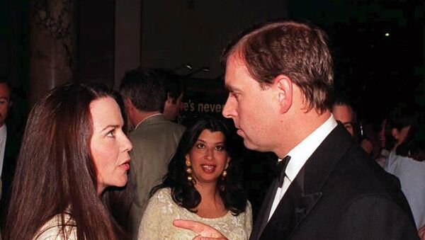 Prince Andrew (R) chats to his old flame, photographer Koo Stark, as they meet during a reception following his official opening of the Canon Photographic Gallery at the Victoria & Albert Museum in London this Tuesday evening, 19 MAY.  - Sputnik International