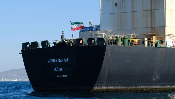 An Iranian flag flutters on board the Adrian Darya oil tanker, formerly known as Grace 1, off the coast of Gibraltar on August 18, 2019. - Gibraltar rejected a US demand to seize the Iranian oil tanker at the centre of a diplomatic dispute as it prepared to leave the British overseas territory after weeks of detention. - Sputnik International