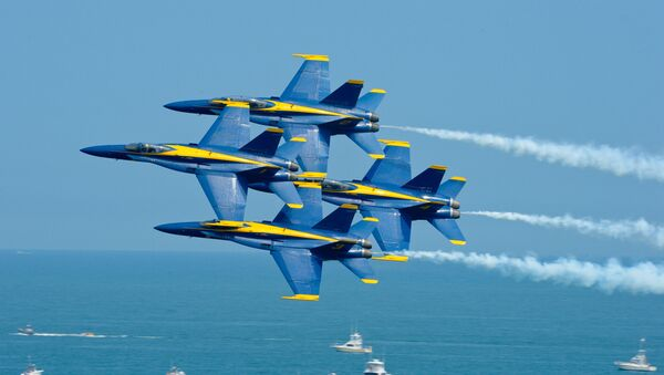 The U.S. Navy flight demonstration squadron, the Blue Angels, perform the Diamond 360 maneuver at the Ocean City Air Show. The Blue Angels are scheduled to perform 68 demonstrations at 35 locations across the U.S. in 2015. - Sputnik International