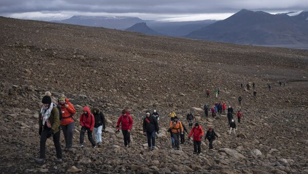 People climb to the top of what once was the Okjokull glacier, in Iceland, Sunday, Aug. 18, 2019.  - Sputnik International