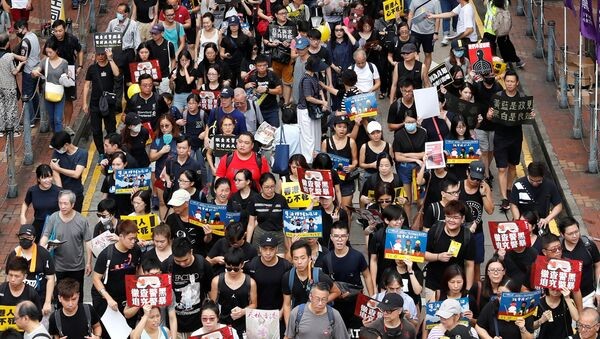 Anti-extradition bill protesters march to demand democracy and political reforms, in Hong Kong, China August 18, 2019. REUTERS/Tyrone Siu - Sputnik International