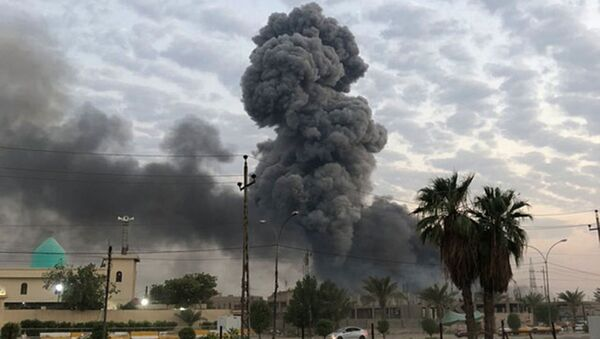In this Monday, Aug. 12, 2019 file photo, plumes of smoke rise after an explosion at a military base southwest of Baghdad, Iraq. A fact-finding committee appointed by the Iraqi government to investigate a massive munitions depot explosion near the capital Baghdad has concluded that the blast was the result of a drone strike. A copy of the report was obtained by The Associated Press Wednesday, Aug. 21, 2019 - Sputnik International
