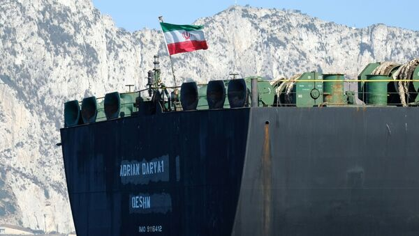 An Iranian flag flutters on board the Adrian Darya oil tanker, formerly known as Grace 1, off the coast of Gibraltar on August 18, 2019. - Sputnik International