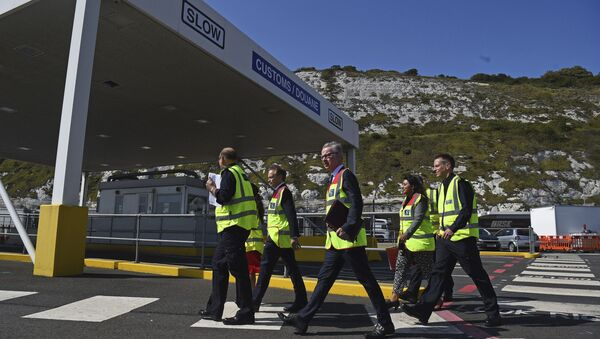Chancellor of the Duchy of Lancaster Michael Gove, centre and Transport Secretary Grant Shapps walk, during a visit to the Port of Dover for a meeting with port officials about the work they are doing to ensure the UK's smooth exit from the European Union, in Dover, England, Wednesday, Aug.  7, 2019 - Sputnik International