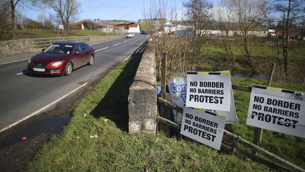 A Motorist crosses the Irish border in Middletown, Northern Ireland, Tuesday, March, 12, 2019. The issue of a possible physical border between the United Kingdom's Northern Ireland and the Republic of Ireland, an EU state, received scant attention during the 2016 Brexit referendum. But it has proven to be a major stumbling block in the British government's quest for a divorce deal.  - Sputnik International