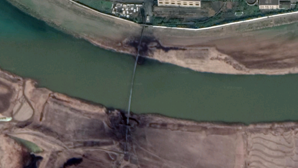 A closeup of the Pyongsan tailings pipe across the Ryesong River, showing leaking at both ends - Sputnik International