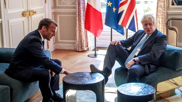 French President Emmanuel Macron and British Prime Minister Boris Johnson speak during a meeting at the Elysee Palace in Paris, France, August 22, 2019. - Sputnik International