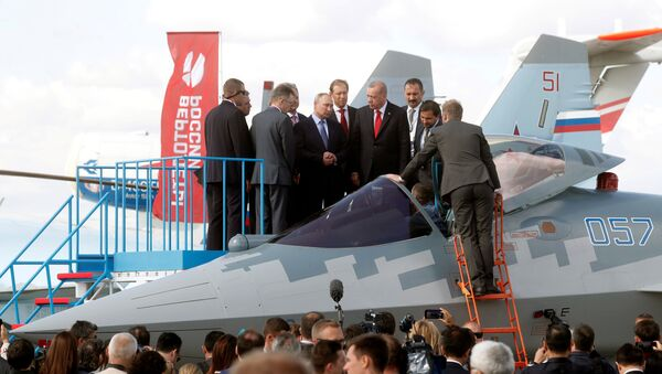 Russian President Vladimir Putin, Russian Industry and Trade Minister Denis Manturov and Turkish President Recep Tayyip Erdogan inspect a Sukhoi Su-57 fifth-generation fighter during the MAKS-2019 International Aviation and Space Salon in Zhukovsky outside Moscow, Russia, August 27, 2019 - Sputnik International