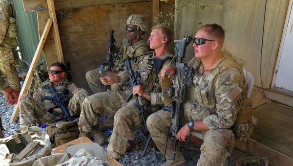 U.S. military advisers from the 1st Security Force Assistance Brigade sit at an Afghan National Army base in Maidan Wardak province, Afghanistan August 6, 2018 - Sputnik International