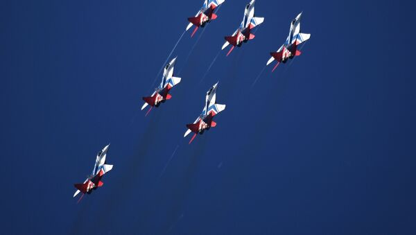 MiG-29 fighter jets piloted by the Swifts aerobatic team perform at the MAKS-2019 international air show in Zhukovsky, outside Moscow. - Sputnik International