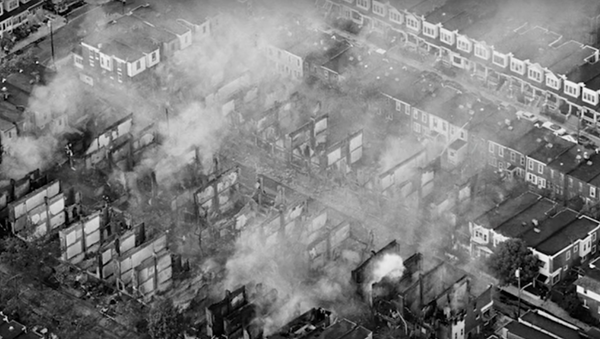 Photo of charred houses following the 1985 bombing of MOVE headquarters/home - Sputnik International