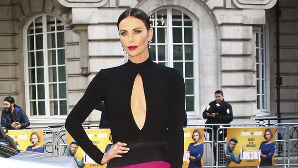 Charlize Theron poses for photographers at the premiere of the film 'Long Shot' in London, Thursday, April 25, 2019.  - Sputnik International