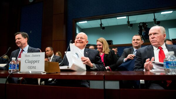 From left, then-FBI Director James Comey, then-Director of National Intelligence James Clapper, and then-CIA Director John Brennan arrive at a House Intelligence Committee hearing on world wide threats on Capitol Hill in Washington, Thursday, Feb. 25, 2016. - Sputnik International