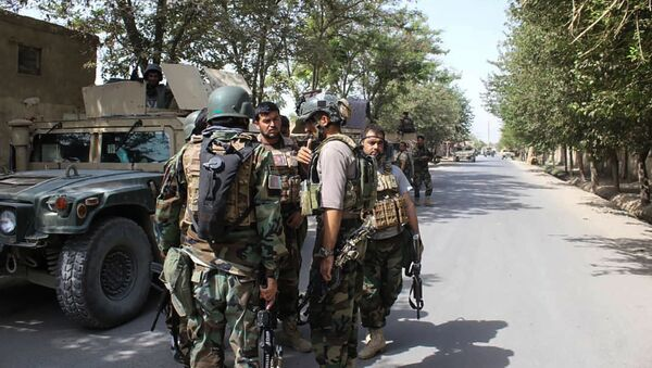 Afghan soldiers gather at a street in Kunduz on August 31, 2019. - Afghan security forces repelled a coordinated Taliban assault on the northern city of Kunduz on August 31, President Ashraf Ghani said, amid competing claims from the insurgents.  - Sputnik International