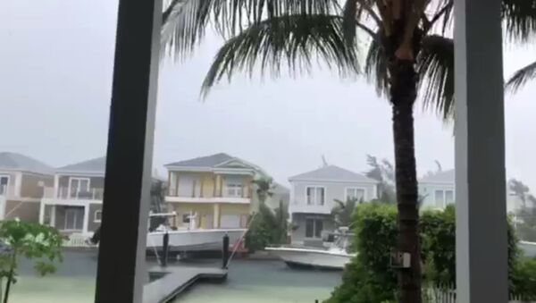 This video grab image shows boats are tied up in preparation for the approach of Hurricane Dorian on September 1, 2019 in Sandyport, Nassau, Bahamas. - Sputnik International