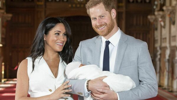 Britain's Prince Harry and Meghan, Duchess of Sussex, during a photocall with their newborn son, in St George's Hall at Windsor Castle, Windsor, south England, Wednesday May 8, 2019 - Sputnik International