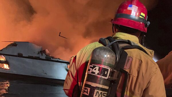 In this photo provided by the Ventura County Fire Department, VCFD firefighters respond to a boat fire off the coast of southern California, Monday, Sept. 2, 2019 - Sputnik International