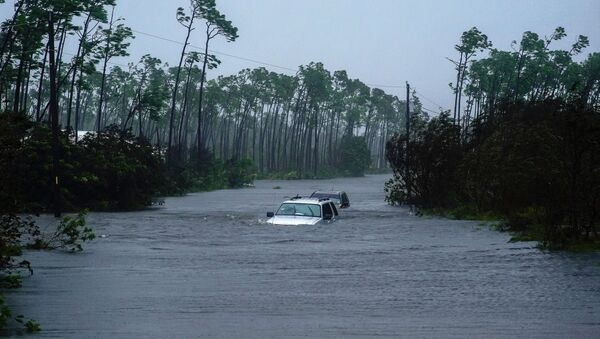 Cars sit submerged in water from Hurricane Dorian in Freeport, Bahamas, Tuesday, Sept. 3, 2019. Dorian is beginning to inch northwestward after being stationary over the Bahamas, where its relentless winds have caused catastrophic damage and flooding.(AP Photo/Ramon Espinosa) - Sputnik International