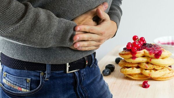 Man holding stomach - Sputnik International