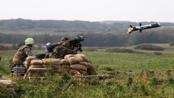 Soldiers from 51 Squadron RAF Regiment fire a Javelin anti tank missile during a training exercise  - Sputnik International