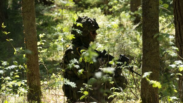 Estonian soldiers take part in an annual military exercise together with several units from other NATO member states on May 18, 2014 near Voru close to the Estonian-Russian border in South Estonia. - Sputnik International