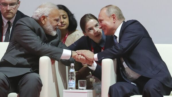 Russian President Vladimir Putin, right, shakes hands with Indian Prime Minister Narendra Modi before the International Jigoro Kano Judo Tournament at the 5th Eastern Economic Forum in Vladivostok, Russia, on Thursday, Sept. 5, 2019 - Sputnik International