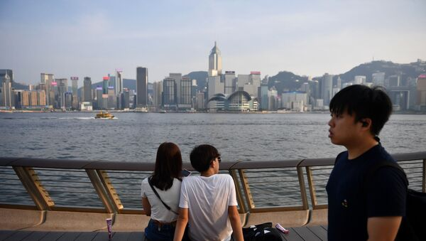 Visitors look at the view along Victoria Harbour in Hong Kong on August 22, 2019. - Sputnik International