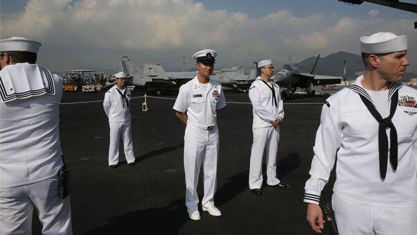 U.S. Navy sailors stand on the deck of the USS Ronald Reagan aircraft carrier in Hong Kong, Wednesday, Nov. 21, 2018 - Sputnik International