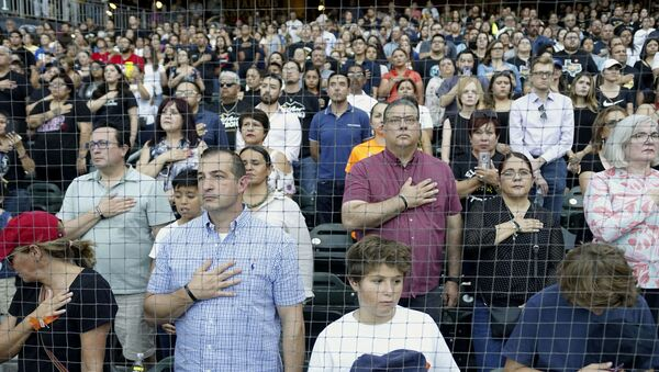 People attend a community memorial service honoring victims of the mass shooting earlier this month which left 22 people dead and 24 more injured, at Southwest University Park on August 14, 2019 in El Paso, Texas. - Sputnik International